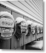 snow covered electricity meters in Saskatoon Saskatchewan Canada Metal Print