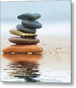 Stack Of Beach Stones On Sand Metal Print