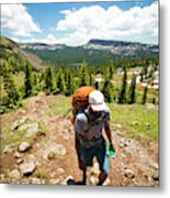 A Backpacker Hiking Metal Print