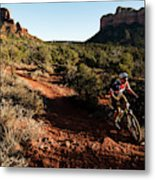 A Middle Age Man Rides His Mountain Metal Print