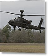 An Ah-64 Apache Helicopter In Midair Metal Print