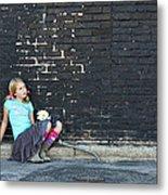 Girl Sitting On Ground Next To Brick Wall Metal Print