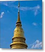 Golden Pagoda With Blue Sky At Wat Phra That Hariphunchai Metal Print