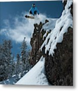 A Male Snowboarder Wearing A Bright Metal Print
