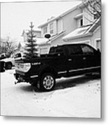 4x4 Pickup Trucks Parked In Driveway In Snow Covered Residential Street During Winter Saskatoon Sask Metal Print