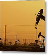 California Oil Field Under Amber Sky Metal Print