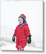 A Two Year Old Boy Plays In A Snowy Metal Print
