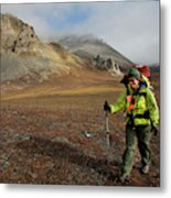 A Backpacker Makes Her Way Metal Print