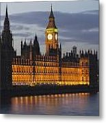 A Building And Clock Tower Along The Metal Print by Charles Bowman