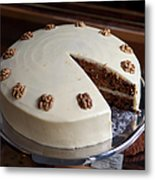 A Carrot Cake On A Display Cabinet In A Metal Print