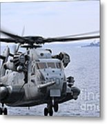 A Ch-53e Super Stallion Conducts Flight Metal Print