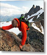 A Climber Scrambles Up A Rocky Mountain Metal Print