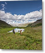 A Couple Hiking Through A Field Metal Print