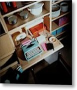 A Cupboard With A Blue Typewriter Metal Print