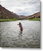 A Fly Fisherman Mends While Fishing Metal Print