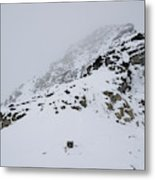 A Hiker Approaches A Snowy Peak Covered Metal Print