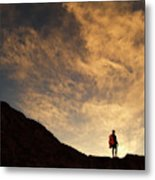 A Hiker Standing On A Ridge At Sun Rise Metal Print