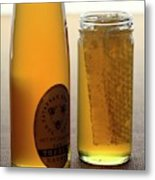 A Jar And Bottle Of Honey Metal Print
