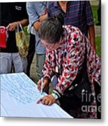 A Lady Signs Petition At May Day Rally Singapore Metal Print