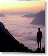 A Lone Hiker Above The Clouds Metal Print