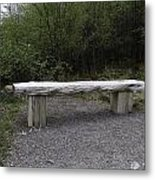 A Long Stone Section Over Wooden Stumps Forming A Rough Sitting Area Metal Print