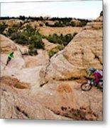 A Male And Female Mountain Biker Ride Metal Print