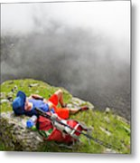 A Male Hiker Is Resting In A Grassy Metal Print