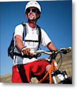 A Male Mountain Biker Stops To Enjoy Metal Print