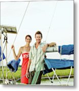 A Man And A Woman Embrace In Sailboat Metal Print