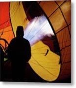 A Man As He Inflates A Hot Air Balloon Metal Print