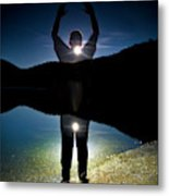 A Man Balances On A Log At Night Metal Print