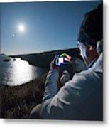 A Man Captures The Full Moon Metal Print