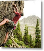 A Man Clinging To Rock Face In The Metal Print