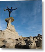 A Man Hiking And Exploring The Complex Metal Print