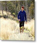 A Man In A Blue Jacket Walks Metal Print
