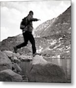 A Man Jumps From One Rock To Another Metal Print