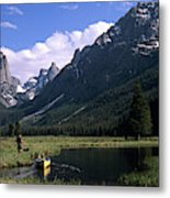 A Man Pulls His Canoe Up A River Valley Metal Print