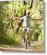 A Man Rides A Bicycle Metal Print