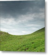 A Man Sitting On Top Of A Tundra Ridge Metal Print