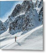 A Man Ski Touring In The Mountains Metal Print