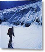A Man Ski Touring Under Blue Skies Metal Print