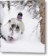 A Man Skiing Powder In The Trees Metal Print