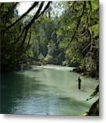 A Man Stands In A River Wearing Waders Metal Print