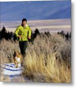 A Man Trail Runs On A Winter Day Metal Print