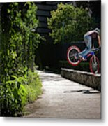 A Man With A Bike Standing On The Front Metal Print