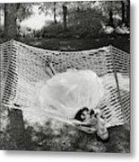 A Model Lying On A Hammock Metal Print
