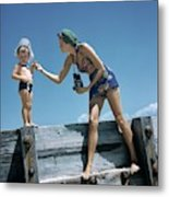 A Mother And Son On A Pier Metal Print