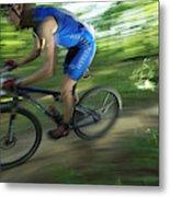 A Mountain Biker Races On A Trail Metal Print