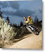 A Mountain Biker Rides A Trail Metal Print
