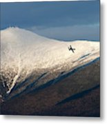 A Plane Flies In The Distance Over Mt Metal Print
